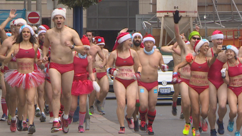 Cheeky Santas dash through Yorkville to raise funds for SickKids Hospital