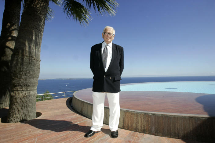 FILE - In this Oct.6, 2008 file photo, French fashion designer Pierre Cardin poses before the presentation of his entire Spring-Summer 2009 and Autumn-Winter 2009 collections at his villa in Theoule sur Mer, southern France. France's Academy of Fine Arts says Pierre Cardin, the French designer whose Space Age style was among the iconic looks of 20th-century fashion, has died at 98. (AP Photo/Lionel Cironneau, File)