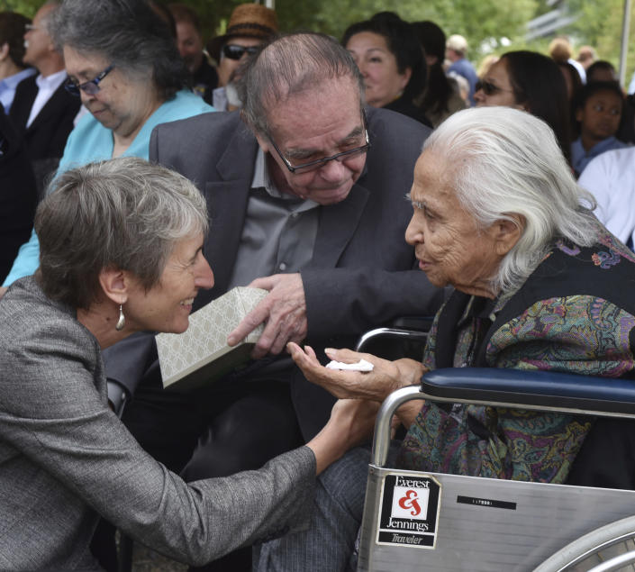 "FILE - In this July 19, 2016 file photo Hank Adams, center, looks on as U.S. Interior Secretary Sally Jewell, left, greets 92 year-old Maiselle Bridges, right, during the celebration of the renaming of Nisqually National Wildlife Refuge near Olympia, Wash. Henry ""Hank"" Adams, Assiniboine-Sioux, died Dec. 21, 2020 at St. Peter's Hospital in Olympia, Wash., according to the Northwest Indian Fisheries Commission. Influential Native American rights advocate and author Vine Deloria Jr. called Adams the ""most important Indian"" because he was involved with nearly every major event in American Indian history from the 1960s forward. (Steve Bloom/The Olympian via AP)"