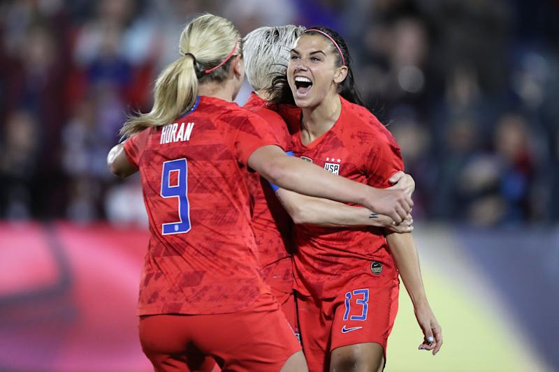 COMMERCE CITY, CO - APRIL 04: United states forward Alex Morgan (13) celebrates scoring her 100th goal with United states forward Megan Rapinoe (15) and teammates in game action during an International friendly match between the United states and Australia on April 4, 2019, at Dick's Sporting Goods Park in Commerce City, CO. (Photo by Robin Alam/Icon Sportswire via Getty Images)