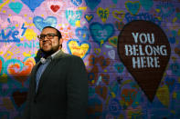 Ricky Hurtado, a Democratic candidate for the North Carolina state house, poses for a portrait by a mural in Graham, N.C., Tuesday, March 10, 2020. He is the first Latino candidate to run for North Carolina's House of Representatives. (AP Photo/Jacquelyn Martin)