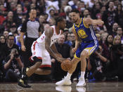 Toronto Raptors forward Kawhi Leonard (2) drives on Golden State Warriors guard Klay Thompson (11) during first half basketball action in Game 1 of the NBA Finals in Toronto on Thursday, May 30, 2019. (Frank Gunn/The Canadian Press via AP)