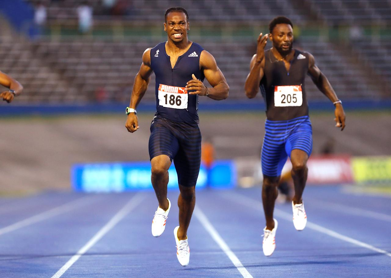 Athletics - JAAA National Senior Championships - Men's 200m final - National Stadium Kingston, Jamaica - June 25, 2017 Jamaica's Yohan Blake (L) and Rasheed Dwyer in action. REUTERS/Lucy Nicholson     TPX IMAGES OF THE DAY