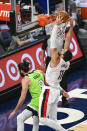 Portland Trail Blazers center Enes Kanter(11) dunks over Minnesota Timberwolves guard Ricky Rubio (9) during the first half of an NBA basketball game Saturday, March 13, 2021, in Minneapolis. (AP Photo/Craig Lassig)