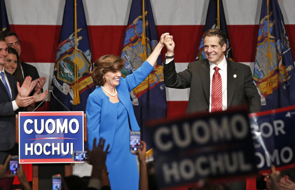 Gov. Andrew Cuomo, right, celebrates with his running mate, Lt. Gov. Kathy Hochul after defeating Republican challenger Rob Astorino, at Democratic election headquarters in New York, Tuesday, Nov. 4, 2014. (Kathy Willens/AP)