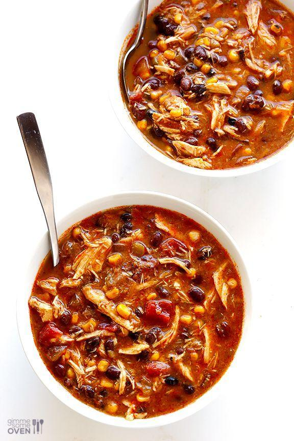 "<p>Toss ingredients like tomatoes, beans, and chiles into a slow cooker to get this spicy soup ready in no time.</p><p><strong>Get the recipe at <a href=""http://www.gimmesomeoven.com/slow-cooker-chicken-enchilada-soup-recipe/"" rel=""nofollow noopener"" target=""_blank"" data-ylk=""slk:Gimme Some Oven"" class=""link rapid-noclick-resp"">Gimme Some Oven</a>.</strong></p>"