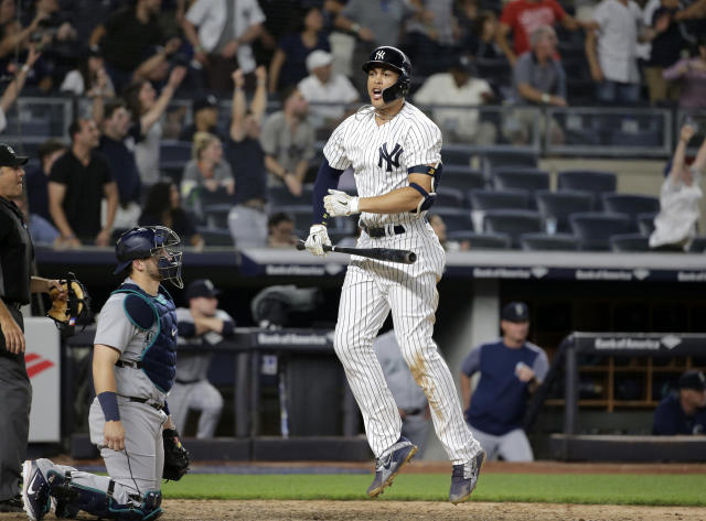 New York Yankees' Giancarlo Stanton reacts after hitting a walk-off two-run home run during the ninth inning of a baseball game against the Seattle Mariners at Yankee Stadium Wednesday, June 20, 2018, in New York. The Yankees defeated the Mariners 7-5. (AP Photo/Seth Wenig)