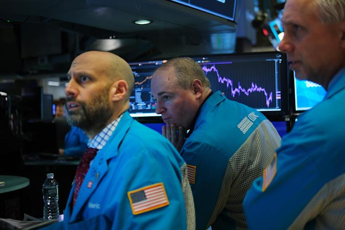 NEW YORK, NEW YORK - JANUARY 27: Traders work on the floor of the New York Stock Exchange (NYSE) on January 27, 2020 in New York City. U.S. stocks fell sharply in morning trading as fears over the spreading coronavirus continue to unsettle global markets. The Dow Jones Industrial Average fell over 400 points after the Opening Bell. (Photo by Spencer Platt/Getty Images)