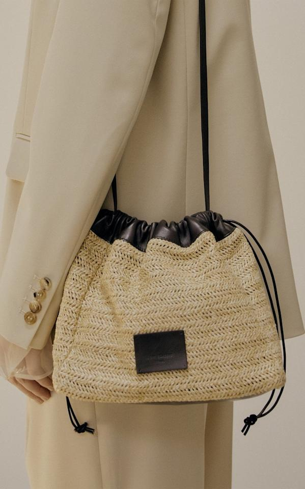 "<p>We'd wear this <product href=""https://www.modaoperandi.com/low-classic-r21/contrasting-leather-and-rattan-shoulder-bag?size=OS"" target=""_blank"" class=""ga-track"" data-ga-category=""Related"" data-ga-label=""https://www.modaoperandi.com/low-classic-r21/contrasting-leather-and-rattan-shoulder-bag?size=OS"" data-ga-action=""In-Line Links"">Low Classic Contrasting Leather and Rattan Shoulder Bag</product> ($390) with pretty much any outfit.</p>"
