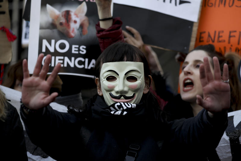 Animal rights activists demonstrates outside Congress in Buenos Aires, Argentina, Wednesday, Aug. 7, 2019. Veganism, a current that emerged in London during World War II, is based on a diet free of animal products, unlike vegetarians who accept the intake of milk or eggs. Vegans also reject all forms of animal exploitation, whether as labor, or for clothing, cosmetics, transportation, sports or scientific experimentation. (AP Photo/Natacha Pisarenko)