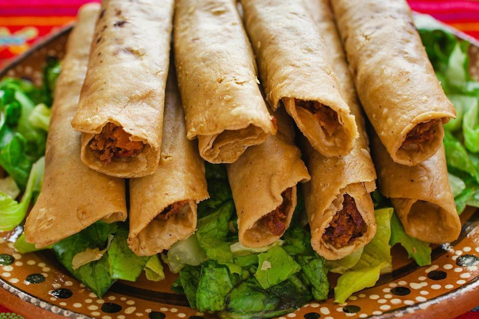 """<p>These crispy chicken flautas will require some <a href=""""https://www.thedailymeal.com/cook/how-to-fry-food-at-home-tips?referrer=yahoo&category=beauty_food&include_utm=1&utm_medium=referral&utm_source=yahoo&utm_campaign=feed"""" rel=""""nofollow noopener"""" target=""""_blank"""" data-ylk=""""slk:at-home frying"""" class=""""link rapid-noclick-resp"""">at-home frying</a> skill, but nothing too difficult. </p> <p><strong><a href=""""https://www.thedailymeal.com/recipes/chicken-flautas-recipe-0?referrer=yahoo&category=beauty_food&include_utm=1&utm_medium=referral&utm_source=yahoo&utm_campaign=feed"""" rel=""""nofollow noopener"""" target=""""_blank"""" data-ylk=""""slk:For the Chicken Flautas recipe, click here."""" class=""""link rapid-noclick-resp"""">For the Chicken Flautas recipe, click here.</a></strong></p>"""