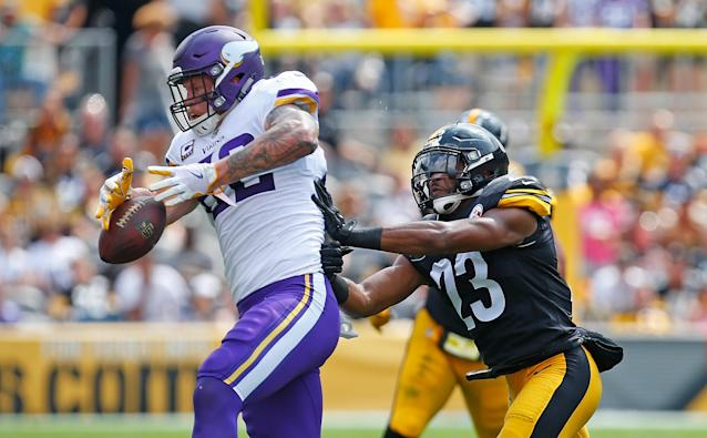 <p>Kyle Rudolph #82 of the Minnesota Vikings cannot come up with a catch while being hit by Mike Mitchell #23 of the Pittsburgh Steelers in the first half during the game at Heinz Field on September 17, 2017 in Pittsburgh, Pennsylvania.. (Photo by Justin K. Aller/Getty Images) </p>
