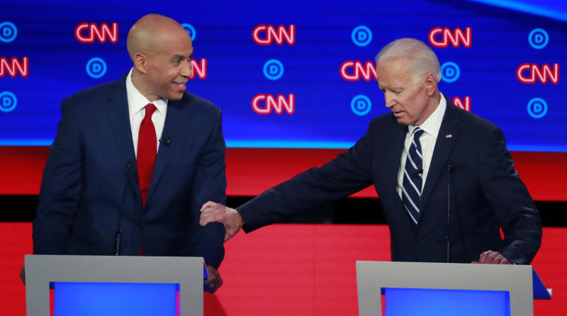 Former Vice President Joe Biden (R) touches U.S. Senator Cory Booker on the second night of the second 2020 Democratic U.S. presidential debate in Detroit, Michigan, July 31, 2019. REUTERS/Lucas Jackson - HP1EF810426NR