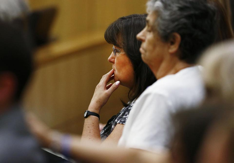 Sandra Arias, center, reacts after her daughter, Jodi Arias, was found of guilty of first-degree murder in the gruesome killing her one-time boyfriend, Travis Alexander, in their suburban Phoenix home, Wednesday, May 8, 2013, at Maricopa County Superior Court in Phoenix. (AP Photo/The Arizona Republic, Rob Schumacher, Pool)