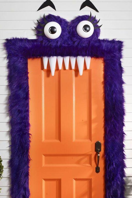 "<p>This furry purple exterior means you don't have to worry about scaring the youngest trick-or-treaters! (And those friendly eyebrows and teeth totally steal the show.)</p><p><strong>Make the Monster Door:</strong> To make eyes, paint black circles on two 8"" foam half balls; let dry. Paint on white highlight. Cut eyelashes and eyebrows from black foam. Cut two 16"" squares and hot-glue each around a 12"" foam wreath, from three yards faux purple fur. Glue eyeballs in center and eyelashes across top. Add a string across back of each eye for hanging. Frame door with strips of fur using pieces of double-sided tape. <br></p><p>Use Command Hooks to hang eyes above door. Tack or tape eyebrows in place. For teeth, use foam cones, and then attach to top of door frame with double-sided tape. </p><p><strong><a class=""link rapid-noclick-resp"" href=""https://www.amazon.com/Faux-Fabric-Solid-SHAGGY-Purple/dp/B016R3UD96/ref=sr_1_3?tag=syn-yahoo-20&ascsubtag=%5Bartid%7C10050.g.22350299%5Bsrc%7Cyahoo-us"" rel=""nofollow noopener"" target=""_blank"" data-ylk=""slk:SHOP PURPLE FAUX FUR"">SHOP PURPLE FAUX FUR</a></strong></p>"