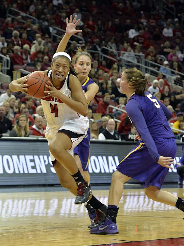 Louisville's Antonita Slaughter, left, fights her way through the defense of LSU's Anne Pedersen, center, and Jeanne Kenney during the second half of an NCAA college basketball game on Thursday, Nov. 14, 2013, in Louisville, Ky. Louisville defeated LSU 88-67. (AP Photo/Timothy D. Easley)