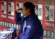 Los Angeles Dodgers' Hyun-jin Ryu, of South Korea, sits in the dugout after coming out of baseball game against the Arizona Diamondbacks during the seventh inning on Saturday, April 13, 2013, in Phoenix. (AP Photo/Matt York)