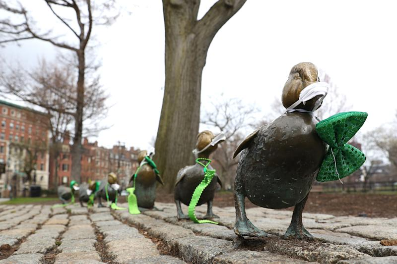 """The """"Make Way for Ducklings"""" sculpture in Boston, Massachusetts wears face masks. (Photo: Maddie Meyer/Getty Images)"""