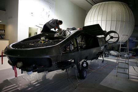 A worker works on a prototype of the Cormorant, a drone, at Urban Aeronautics' workshop in Yavne, Israel December 22, 2016.  REUTERS/Amir Cohen
