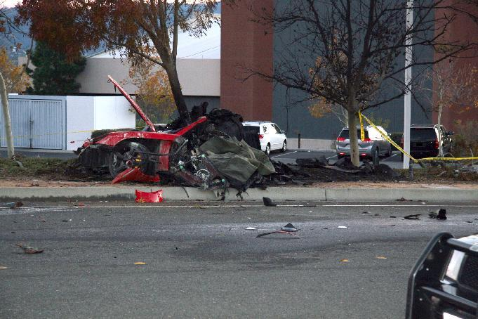"""In this Nov. 30, 2013 photo released by the Los Angeles County Sheriff Department on Tuesday, March 25, 2014, shows the wreckage of a Porsche that crashed into a light pole in Valencia, Calif. Crash investigators have determined that the car carrying """"Fast & Furious"""" star Paul Walker was traveling approximately 90 mph when it lost control on a city street and smashed into a light pole, killing the actor and his friend Roger Rodas. A person who has reviewed the investigators' report told The Associated Press that it concluded unsafe driving, not mechanical problems, caused the crash. The person requested anonymity because the report has not been officially released yet. (AP Photo/Los Angeles County Sheriff)"""