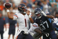 Chicago Bears quarterback Justin Fields (1) passes as he is pressured by Tennessee Titans safety Amani Hooker (37) in the first half of a preseason NFL football game Saturday, Aug. 28, 2021, in Nashville, Tenn. (AP Photo/Wade Payne)