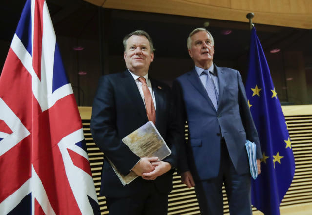 European Union chief Brexit negotiator Michel Barnier, right, speaks with the British Prime Minister's Europe adviser David Frost during the start of the first round of post -Brexit trade talks between the EU and the UK, at EU headquarters in Brussels, Monday, March 2, 2020. (Olivier Hoslet. Pool Photo via AP)