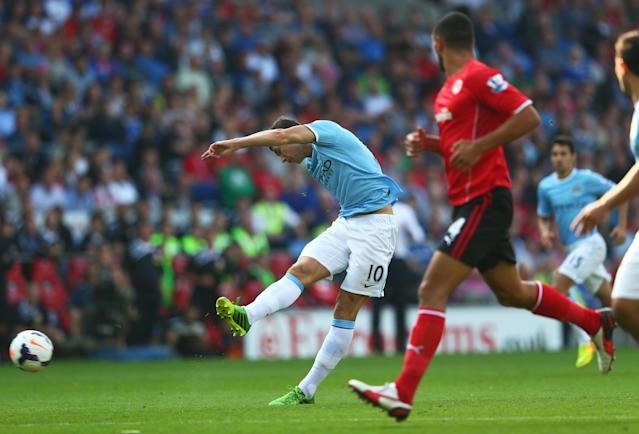 CARDIFF, WALES - AUGUST 25: Edin Dzeko of Manchester City scores the opening goal during the Barclays Premier League match between Cardiff City and Manchester City at Cardiff City Stadium on August 25, 2013 in Cardiff, Wales. (Photo by Michael Steele/Getty Images)