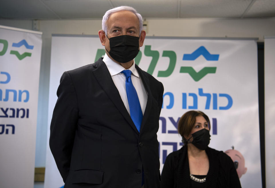 FILE - In this Jan. 13, 2021 file photo, Israeli Prime Minister Benjamin Netanyahu visits a coronavirus vaccination facility in the northern Arab city of Nazareth, Israel. Netanyahu, who has spent much of his long career casting Israel's Arab minority as a potential fifth column led by terrorist sympathizers, is now openly courting their support as he seeks reelection in the country's fourth vote in less than two years. (Gil Eliyahu/Pool via AP, File)