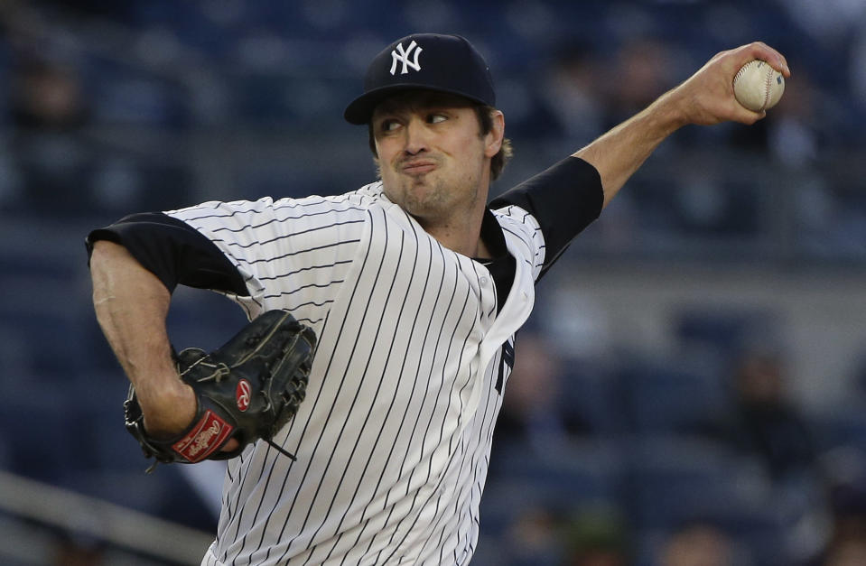 The Indians landed lefty reliever Andrew Miller from the Yankees for four prospects. (AP)
