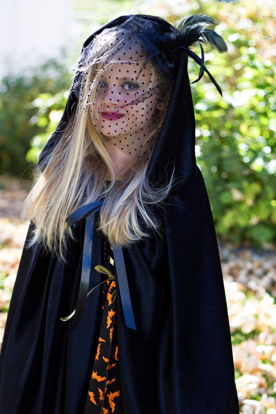 """<p>A dramatic cloak and birdcage veil are the perfect finishing touch for this DIY witch costume.</p><p><strong>Get the tutorial at <a href=""""http://www.doityourselfdivas.com/2014/10/diy-little-girl-witch-costume-for.html?m=1"""" rel=""""nofollow noopener"""" target=""""_blank"""" data-ylk=""""slk:Do It Yourself Divas"""" class=""""link rapid-noclick-resp"""">Do It Yourself Divas</a>. </strong></p><p><a class=""""link rapid-noclick-resp"""" href=""""https://www.amazon.com/Tinksky-Feather-Fascinator-Valentines-Accessory/dp/B01J5AO5CY/ref=sr_1_8?tag=syn-yahoo-20&ascsubtag=%5Bartid%7C10050.g.28304812%5Bsrc%7Cyahoo-us"""" rel=""""nofollow noopener"""" target=""""_blank"""" data-ylk=""""slk:SHOP BIRDCAGE VEILS"""">SHOP BIRDCAGE VEILS</a></p>"""