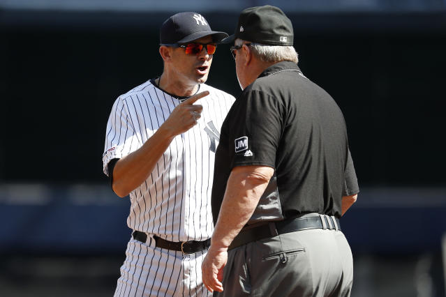 New York Yankees manager Aaron Boone argues with third base umpire Joe West after the first inning of the team's baseball game, Saturday, Sept. 21, 2019, in New York. (AP Photo/Michael Owens)