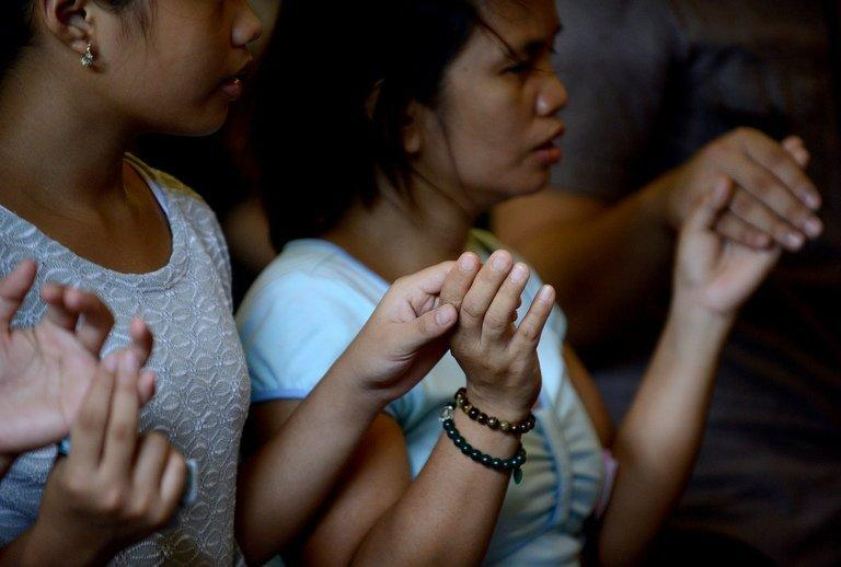 Catholics attend a mass in a small church in Manila on April 21, 2013