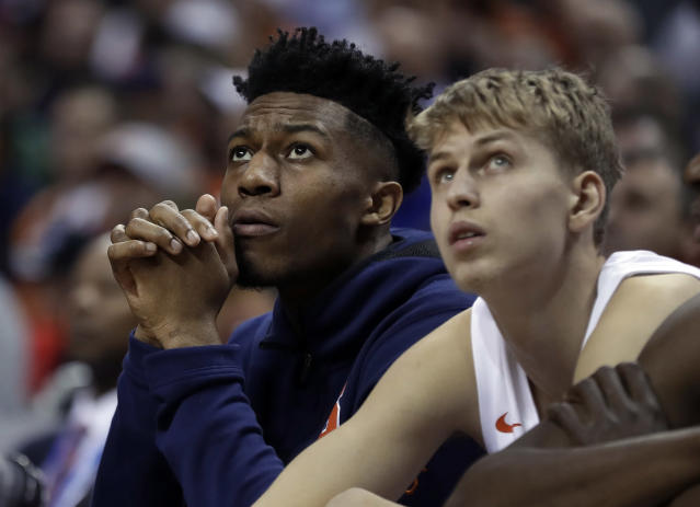 Syracuse's Tyus Battle, left, and Marek Dolezaj look up at a video board during the first half of an NCAA college basketball game against Pittsburgh in the Atlantic Coast Conference tournament in Charlotte, N.C., Wednesday, March 13, 2019. Battle was unable to play due to an injury. (AP Photo/Nell Redmond)