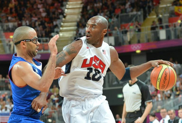 (FILES) In this file photo taken on July 29, 2012 US guard Kobe Bryant (R) is challenged by French guard Tony Parker during the Men's Preliminary Round Group A basketball match United States vs France at the London 2012 Olympic Games in London