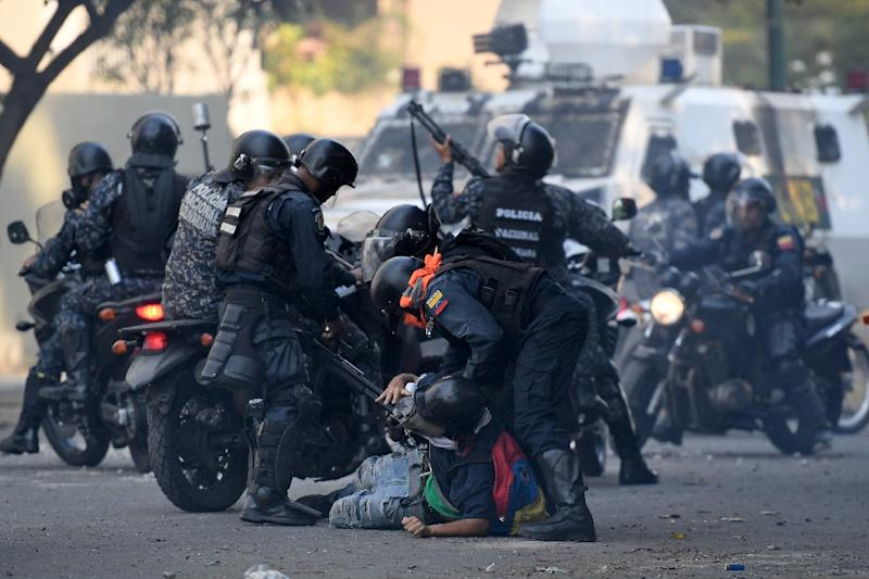 Venezuela is caught in an economic crisis and a political standoff between Maduro and Guaido (AFP Photo/Federico PARRA)