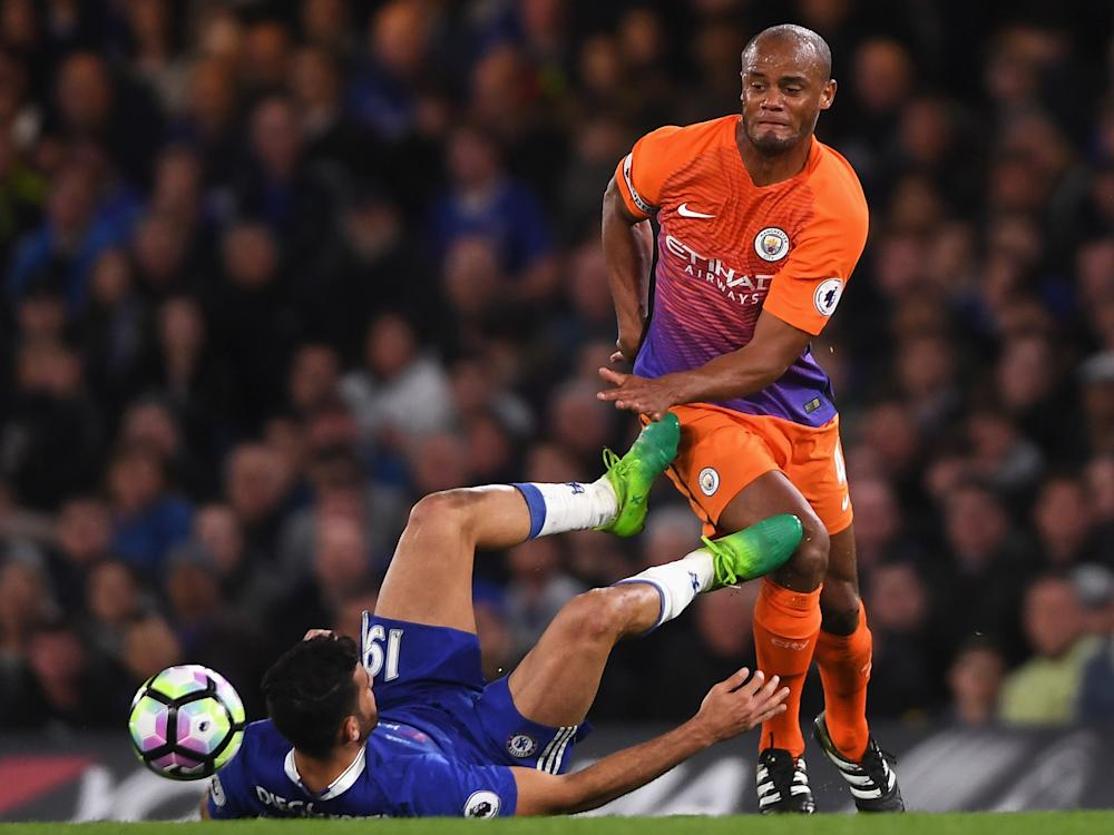Costa appeared to kick out at Kompany after a challenge: Getty