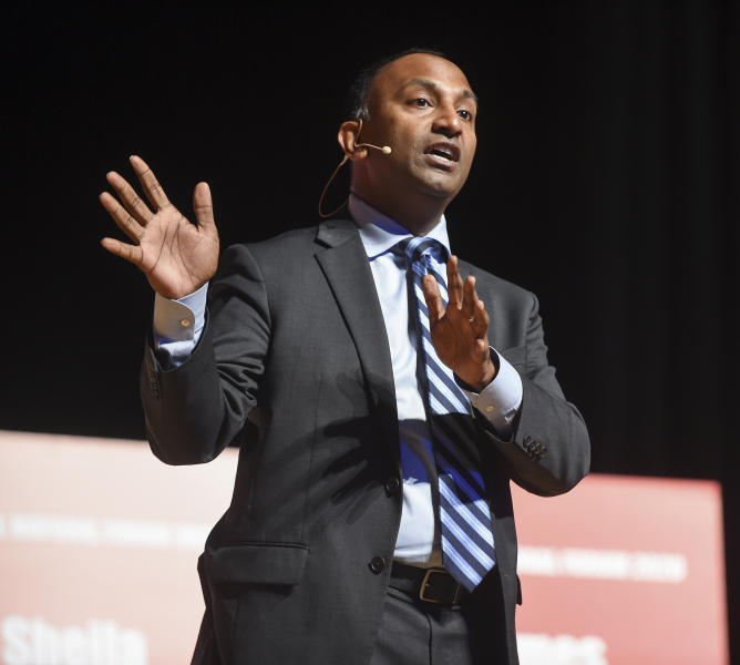 In this Saturday, Jan. 25, 2020, photo, Thiru Vignarajah answers a question during a Baltimore City Mayoral Candidate Forum, hosted by the Greater Baltimore Urban League, at Morgan State University, in Baltimore. (Ulysses Muñoz/The Baltimore Sun via AP)