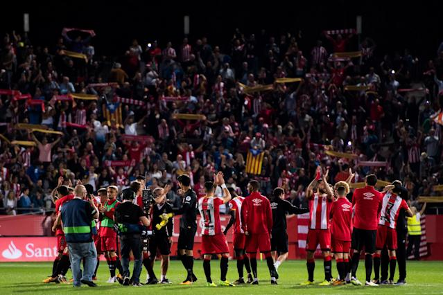 Girona players and fans celebrate their memorable victory over Real Madrid. (Getty)
