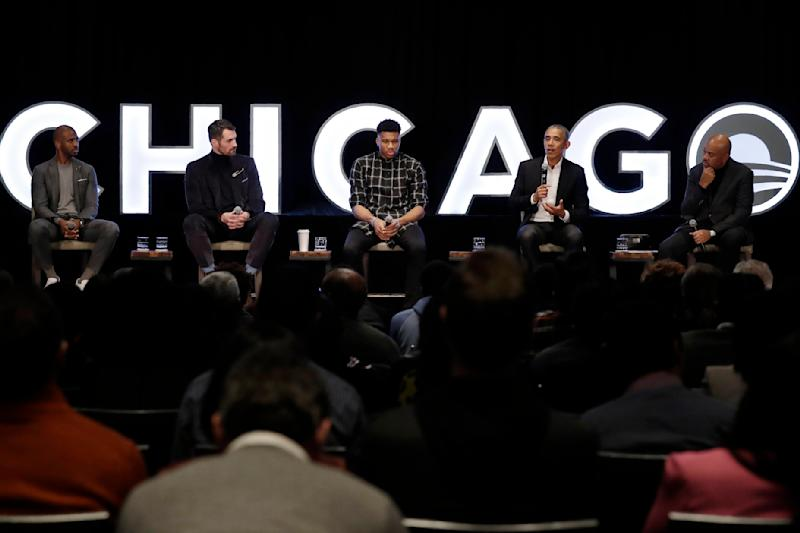Former president Barack Obama, second from right, talks as NBA players Chris Paul, Kevin Love and Giannis Antetokounmpo and sports analyst Michael Wilbon, from left, listen in Chicago, Saturday, Feb. 15, 2020. (AP Photo/Nam Y. Huh)