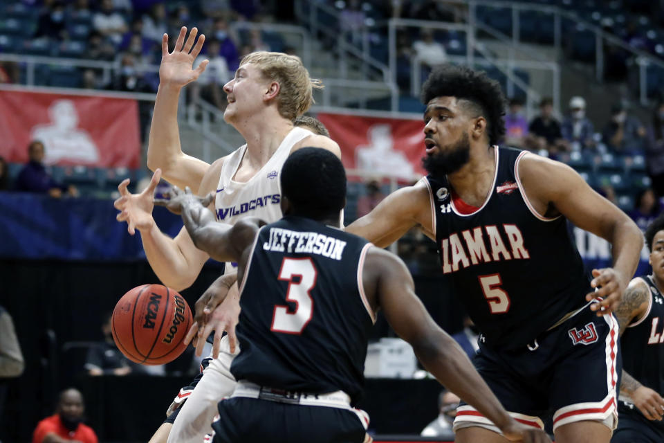 Abilene Christian center Kolton Kohl, left, loses the ball on a shot-attempt under pressure from Lamar guard Ellis Jefferson (3) and forward Avery Sullivan (5) during the first half of an NCAA college basketball game in the Southland Conference semifinals Friday, March 12, 2021, in Katy, Texas. (AP Photo/Michael Wyke)