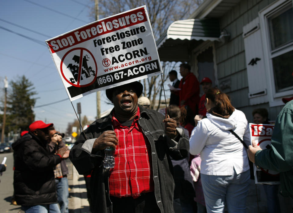 Demonstrators from ACORN's Home Defenders rally outside the foreclosed home of Marie Elie in Elmont, New York, April 9, 2009. (REUTERS/Shannon Stapleton)