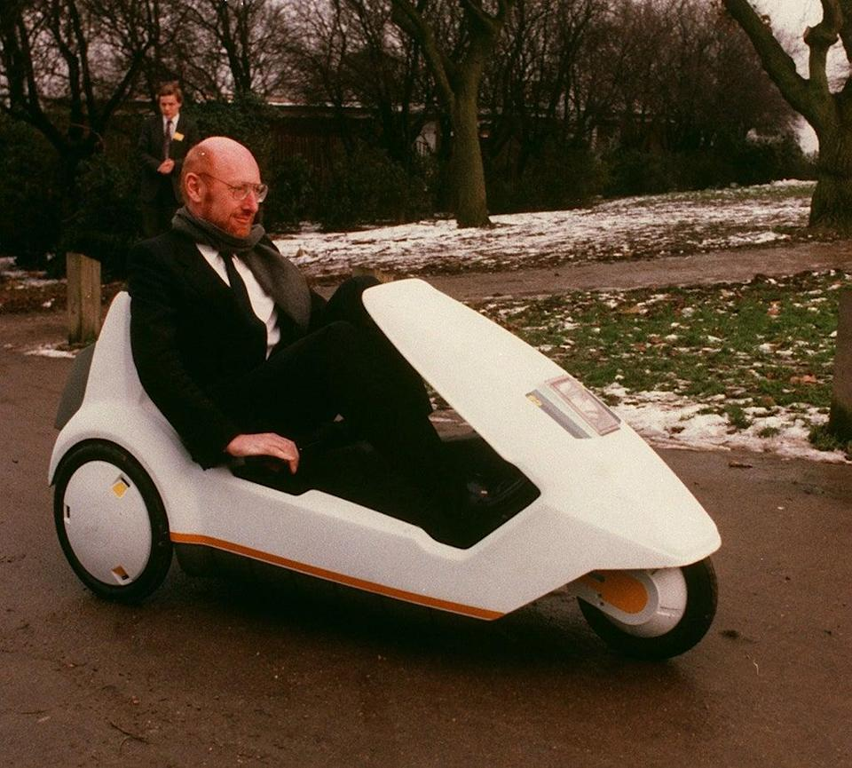 Snow go: in his C5 in London's Alexandra Palace, January 1985. It was a mistake to demonstrate the battery-assisted pedal powered tricycle in the middle of winter (PA)