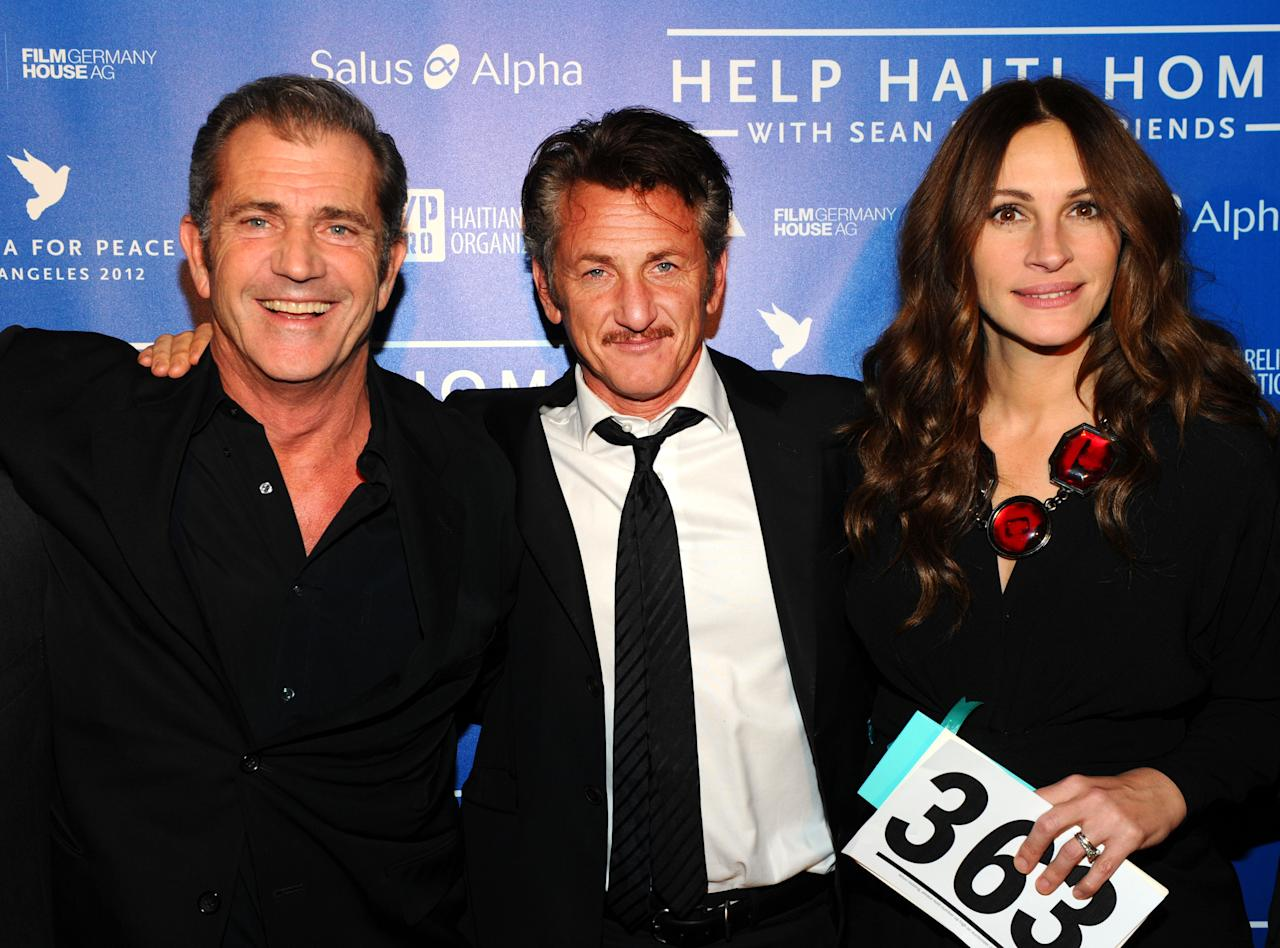 LOS ANGELES, CA - JANUARY 14:  (L-R) Actors Mel Gibson, Sean Penn and Julia Roberts attend the Cinema For Peace event benefitting J/P Haitian Relief Organization in Los Angeles held at Montage Hotel on January 14, 2012 in Los Angeles, California.  (Photo by Michael Buckner/Getty Images For J/P Haitian Relief Organization and Cinema For Peace)