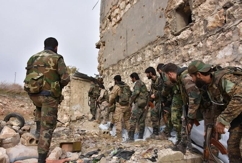 Syrian pro-government troops hold a position in Aleppo's eastern Karm al-Jabal neighborhood as they advance towards al-Shaar neighbourhood on December 5, 2016 during their offensive to retake Syria's second city