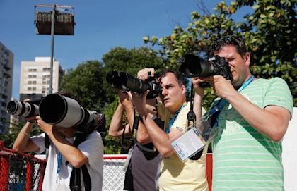 Dutch photographers take photos of the Netherlands' team practice. (Getty)