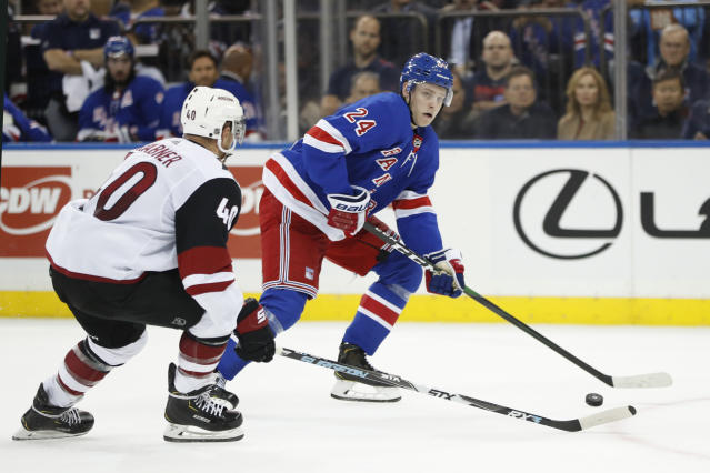 New York Rangers right wing Kaapo Kakko (24) looks to pass the puck as Arizona Coyotes right wing Michael Grabner (40) defends during the second period of an NHL hockey game Tuesday, Oct. 22, 2019, in New York. (AP Photo/Kathy Willens)