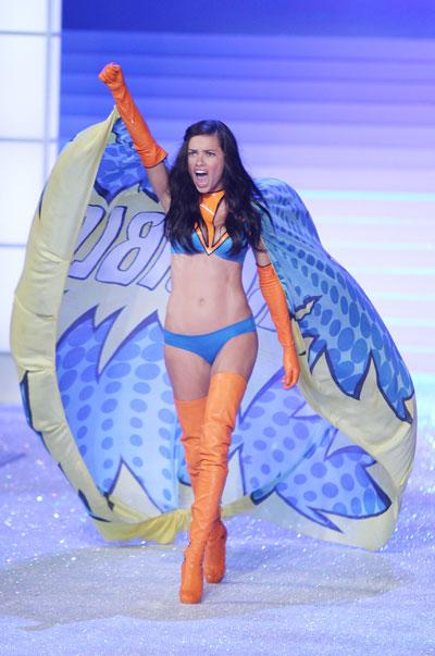 Adriana Lima fully embraces her superhero inspired outfit.