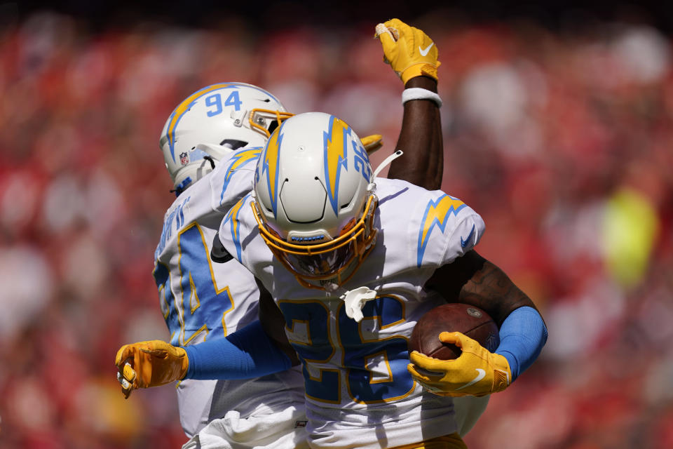 Los Angeles Chargers' Asante Samuel Jr. (26) celebrates an interception with Chris Rumph II (94) during the first half of an NFL football game against the Kansas City Chiefs, Sunday, Sept. 26, 2021, in Kansas City, Mo. (AP Photo/Charlie Riedel)