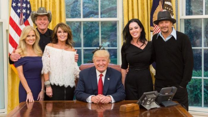Sarah Palin, Ted Nugent and his wife, and Kid Rock and his fiancée posing with President Trump.