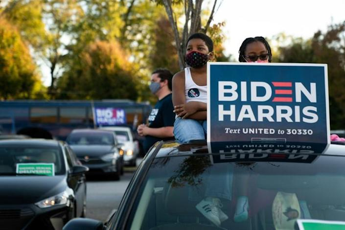 People listen to US vice presidential candidate Kamala Harris during a 'drive-in' rally on October 23, 2020 in Atlanta, Georgia